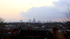london skyline time lapse with residential houses in foreground with london city - stock footage