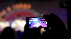 Stock Video Footage of Spectator take a video via smartphone camera of a concert performance