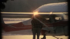 Santa Clause arriving by small plane - stock footage