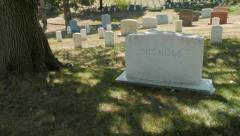 gimbal shot of walking past grave markers in arlington cemetery - stock footage