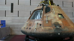 Gimbal shot walking around the apollo 11 command module Stock Footage