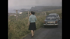 Vintage 16mm film, 1965, North Ireland view of ocean and hills road Stock Footage