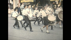 Vintage 16mm film, 1965, North Ireland kids marching band Stock Footage