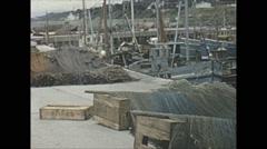 Vintage 16mm film, 1965, North Ireland fishing village nets fishing boats Stock Footage