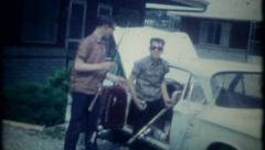 2841 - teenage boys take fishing gear out of car - vintage film home movie Stock Footage