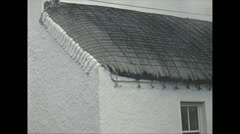 Vintage 16mm film, 1965, North Ireland thatch roof whitewashed cottages Stock Footage