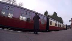 Guard blows whistle and vintage British train leaves the station Stock Footage