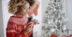 Attractive young woman eating Christmas cake Stock Footage