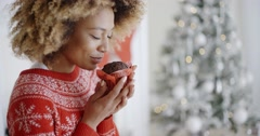 Young woman savoring a Christmas cake Stock Footage