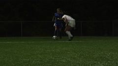 A female soccer player being defended by her opponent - stock footage