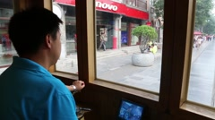 Driver controls the retro tram running down the Qianmen street, Beijing Stock Footage