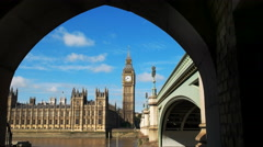 Big ben in london framed by the arch of a bridge Stock Footage