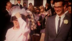 2843 - newlyweds pose for the camera after ceremony - vintage film home movie Stock Footage