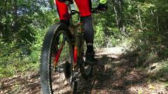 Mountain biker start downhill free ride on bike Stock Footage