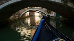 Gondola passes underneath bridges in Venice - stock footage
