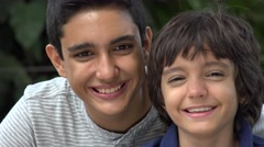 Teen Hispanic Brothers Acting Silly - stock footage