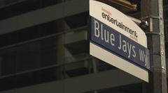 Blue Jays Way Street Sign. Entertainment District Stock Footage