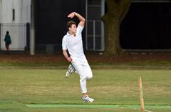 Cricket player bowler reaches his delivery stride Stock Photos