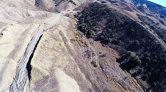 Vasquez canyon landslide and road damage drone aerial - stock footage