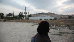 A Palestinian woman just crossed Checkpoint to Israel Stock Footage