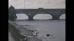 Vintage 16mm film, 1965, North Ireland stone bridge town Stock Footage