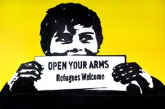"Graffiti with the political slogan ""Refugees Welcome"" - stock photo"