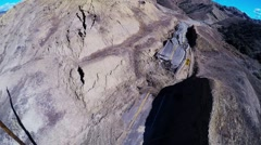 Vasquez canyon landslide and road damage drone aerial Stock Footage