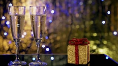 Two champagne glass with a gift box Stock Footage