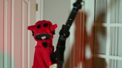Weird puppet with gun Stock Footage