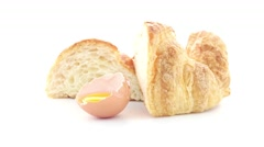 Croissant and egg - stock footage