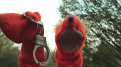Creepy bondage puppet hand cuffs handcuffs Stock Footage