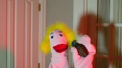 Creepy puppet with a grenade holding Stock Footage