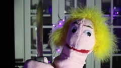 Lady puppet with knife hold holding Stock Footage