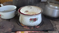 Pot boiling on hearth in rural area Stock Footage