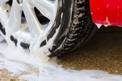 car wash with soap, car cleaning service - stock photo