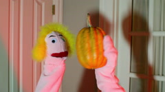 Puppet holding a pumpkin in hand halloween Stock Footage