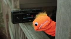 Puppet listening to music listen boombox Stock Footage
