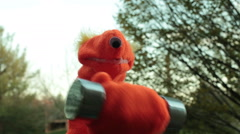 Puppet lifting weights working out work Stock Footage