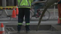 Concrete being poured downtown. Stock Footage