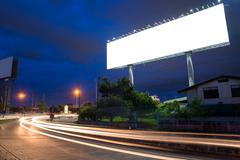 Stock Photo of Blank billboard at twilight time ready for new advertisement
