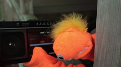 puppet monster listening to music boombox - stock footage