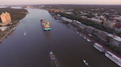 Cargo Ship in Savannah Heads Out to Sea Stock Footage