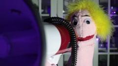 Puppet speaking speak into megaphone mega phone Stock Footage