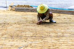 Engineer meshing rebar for flooring with cement. Stock Photos