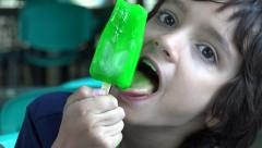 Boy Eating Green Popsicle Stock Footage