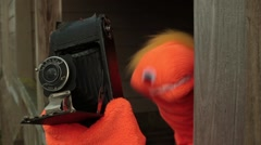 Puppet taking pictures take photos Stock Footage