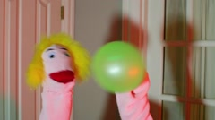 Puppet with a balloon party hold holding Stock Footage