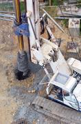 Hydraulic hammer drilling machine at construction site - stock photo