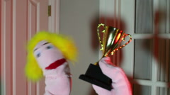 puppet with trophy hold holding - stock footage