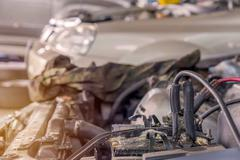 Charging car with electricity trough cables in auto repair shop Stock Photos